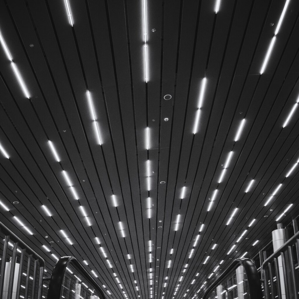 Black and white image on led lights on a roof