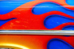 Orange flame design on a blue vehicle